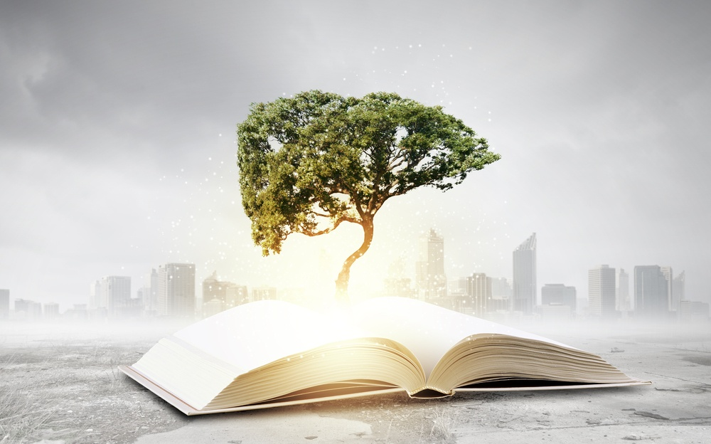 Concept of education and knowledge with tree growing from book.jpeg