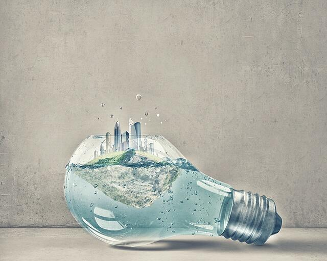 Glass light bulb with water and cityscape inside .jpeg