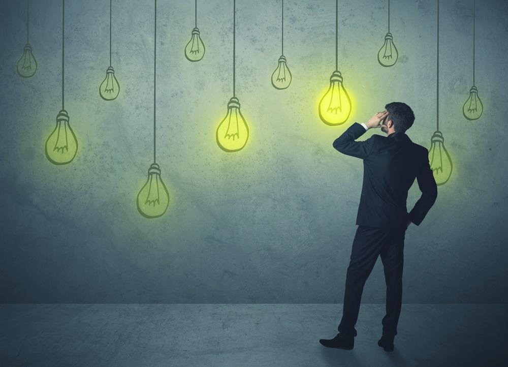 businessman with hanging lighting bulbs.jpeg