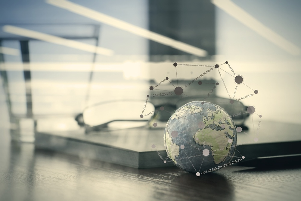 double exposure of hand drawn texture globe with social media diagram on wood table near note book and glasses