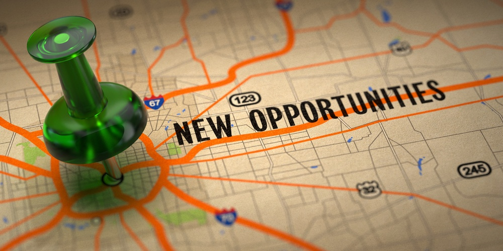 New Opportunities Concept - Green Pushpin on a Map Background with Selective Focus..jpeg